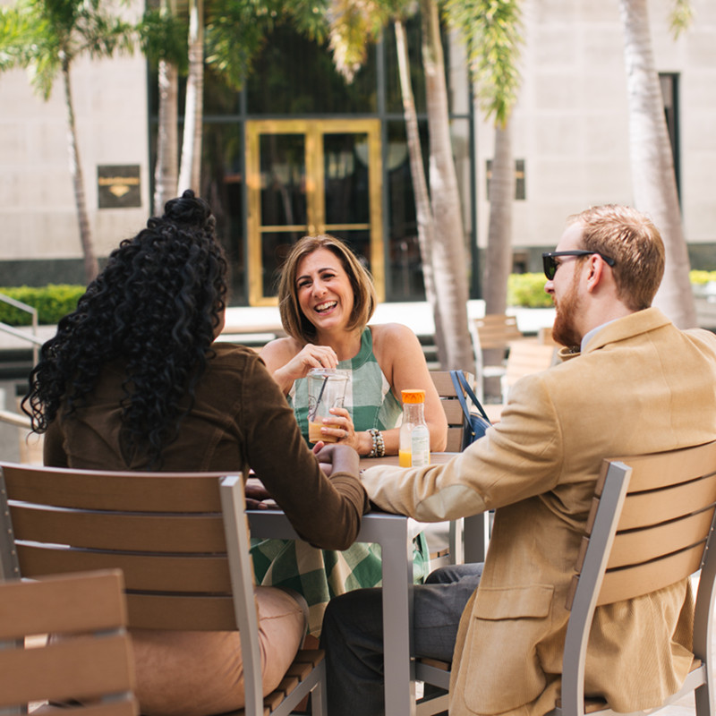 Pregnant couple meeting with their doula at a bistro   The Hospital Doulas   Orlando, FL   A great birth experience